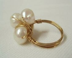 This is a gorgeous cultured freshwater pearl ring with four pearls wrapped in solid gold wire. That's right, solid gold wire, not plated, filled gold, or rolled gold. Wire Jewelry Rings, Handmade Wire Jewelry, Handmade Rings, Wire Earrings, Stone Jewelry, Wire Bracelets, Pearl Necklaces, Jewelry Necklaces, Jewellery