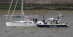 River Police searching a yacht coming into London.