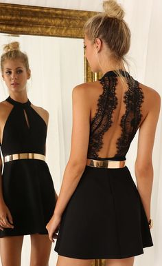 "Cut out little black dress with lace back and ""gold standard belt"""
