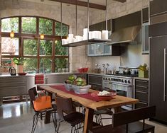 ... and oak—gives this kitchen its appealing rustic-industrial character.