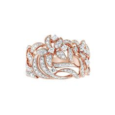 This incredible ring features sparkling 1/2 carat total weight round diamonds in a gorgeous 14 karat rose gold flower design. She will love wearing this ring and it will quickly become one of her favorites. From our Pavé Rose Collection by EFFY. Band w...