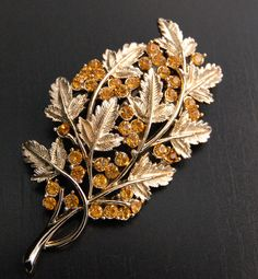 Vintage Coro Citrine & Leaf Brooch on etsy that I'm very tempted to buy at $18.99 (inspired by autumn)