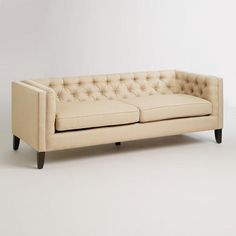 One of my favorite discoveries at WorldMarket.com: Sand Kendall Sofa World Market 77x32 .. think it's too long, but I like the low back