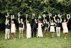 You have just enough in your wedding party for all 12 to have letters (with an exclamation point). Would be cute with the newlyweds kissing between the words.
