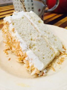 the most luscious coconut cake with coconut buttercream and toasted coconut