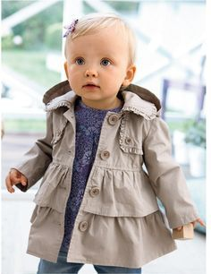 4.) Gorgeous winter baby section. Beige frilled mac, with navy paisley dress and dark blue leggings. Comes with a clip-on bow. Recommend this on 1-3 year olds, it will look beautiful on a baby, against the fresh snow. ❄️ (I got this image off Google images!)