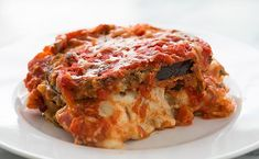 A classic Italian baked Eggplant Parmesan casserole with breaded eggplant slices layered with Mozzarella, Parmesan, basil, and tomato sauce. Baked Eggplant, Eggplant Parmesan, Eggplant Lasagna, Stuffed Eggplant, Vegetarian Recipes, Cooking Recipes, Healthy Recipes, Vegetarian Italian, Healthy Food