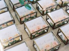"Snippet & Ink on Instagram: ""We love this #escortcard display, says bride, Lauren: ""When it was time to move inside for dinner, guests found their escort cards in a display of small glass jewelry boxes. Each box contained a die-cut card and two or three delicate blush rosebuds."" Event Planning & Design: @eastonevents, photo: @tecpetaja, venue: @pippinhillfarm + florals by @ariellachezardesign"""