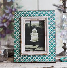 A fabulous way to display your favourite photographs***OUT OF STOCK UNTIL END OF MARCH. ORDER FOR DELIVERY END OF MARCH** This gorgeous aqua design distressed picture frame is a unique way to show your best-loved photographs. It will make a real statement on a mantlepeice or wall. Also an ideal wedding present. This frame is part of Anusha gorgeous clothing, accesories, jewellery and gift collection. Please note that scuffs and marks on the paintwork are part of the distressed look of the…