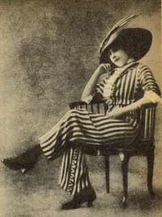 """Imagine the summer of 1905. At the races at Auteuil (near Paris) a woman appeared wearing trousers in public for the first time. Her name is unknown, but this is a picture of her. Police men had to protect her against the curiosity and outrage of the crowd. The incident dominated the newspapers for days on end."""