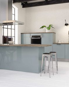 A good blue for kitchen cabinetry against a pale wood floor