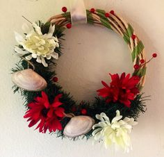 Holiday wreath wrapped with greenery accented by Freebernshells