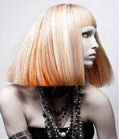 A long blonde straight coloured avant-garde multi-tonal hairstyle by Michael Levine