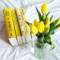 Some yellow tbr-books and tulips to brighten up your day. It's been long since I had a day at home (although even here there's enough to do) and lucky as I am I got ill. But nevermind at least I got flowers. // #bookstagram #tulips #tbr #yellowbooks by eelifant