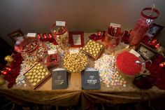 Red and gold candy bar/buffet, always a big hit with guests as an edible wedding reception favor!