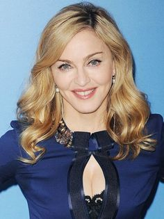 Madonna looks matronly but beautiful in this blue get up.