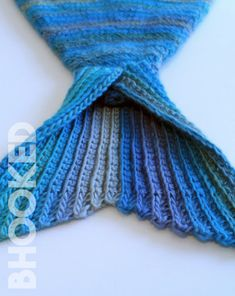 Mermaid tails are a popular thing to crochet these days because they're cute & fun to make. The Mystic Mermaid Cocoon is one of our most popular patterns! Crochet Mermaid Tail Pattern, Mermaid Blanket Pattern, Crochet Mermaid Blanket, Mermaid Quilt, Crochet Blanket Patterns, Crochet Baby Cocoon, Crochet Toddler, Crochet For Kids, Crochet Ideas