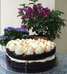 Moist chocolate cake with caramel mascarpone cream and salty caramel sauce