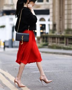 black sweater, red pleated skirt, nude tights & nude heels
