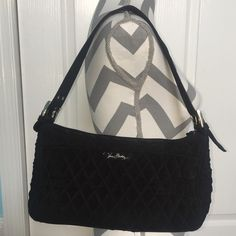 Black Vera Bradley purse Black Vera Bradley handbag. Zipper opening with a zipper pocket on the inside. A large flap pocket with a magnetic closure on the front side of the outside and large pocket with a magnetic closure on the back side. Single handle that is adjustable. Silver accents. Only used a couple times and is in great condition. The size is about 8x14x5. Vera Bradley Bags