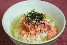 """"""" #Ocha-Zuke """", is one of the famous traditional japanese food. A bowl of rice soaked in hot green tea with food over the rice such as dried fish, pickled vegetables or other seasonings. The photo is called """" Sake-Chazuke """"."""