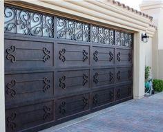 Rod Iron  http://www.sudburyriver.org/wp-content/uploads/2011/10/Iron-Garage-Door-Designs.jpg