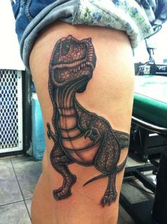 Hi! My name is Gianna. This is my Tyrannosaurus Rex tattoo. I named him Dixon. (After Daryl Dixon in The Walking Dead) This photo was taken immediately after finishing the tattoo. Dixon is the latest of all my tattoos. I got him on March 18th, 2013. I had him done at Ink Link Tattoos in West Palm Beach, Florida, by an AWESOME artist named GARY RAINE. He's done every tattoo on my body, and I have 8 of them. If you're from anywhere near here and looking for a tattoo artist, I HIGHLY recommend Gary