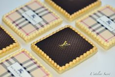 Louis Vuitton and Burberry Cookies.  Now that's fancy!! :)