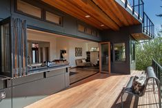 Open wall kitchen and deck - contemporary - patio - seattle - Thomas Jacobson Construction, Inc