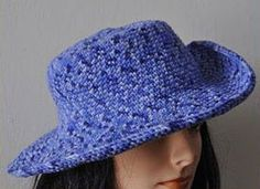 """Cuddles Brim Hat - This wide-brimmed hat is crocheted with a small hook to produce a dense fabric. Mold the brim down for a comfortable gardening hat, or curl up the side edges for a Western look. You can make a taller hat by working the even sc rounds for longer than 3"""", and you can also make a shorter brim by stopping when brim reaches desired width. Size is determined by hook size."""