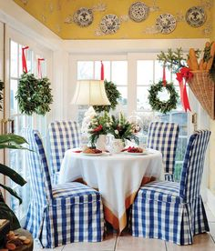 Breakfast room decorated for Christmas - love the wreaths on the windows and buffalo check covered chairs - Betty Peachey and Randy Luken - Touch of Magic - Dayton