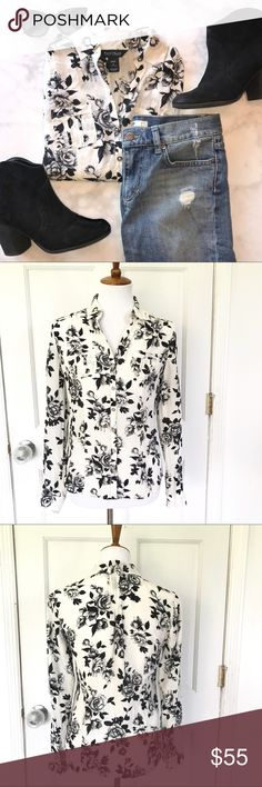 White House black market floral city silk blouse A black and white picture of fall flowers on soft, rippling silk georgette. This shirt is ready to get to work, with roll-tab sleeves and cargo-style pockets. 100% Silk. Size 4. White House Black Market Tops Blouses