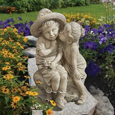 """""""Kissing Kids"""" Boy and Girl Statue. Though it may look like a quick peck on the…"""