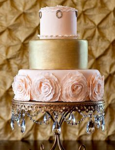 A simple cake, three different textures to incorporate your dress and the rest of your theme.