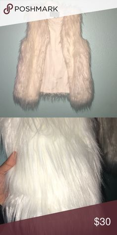 Fur vest Faux white fur. Never worn with tags ! Has hook running down the middle so you can close vest. Jackets & Coats Vests