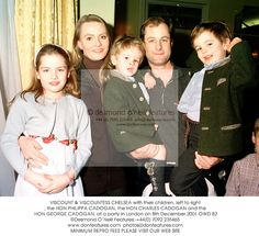 VISCOUNT & VISCOUNTESS CHELSEA with their children, left to right, the HON.PHILIPPA CADOGAN (b. 1992), the HON.CHARLES CADOGAN (b. 1998) and the HON.GEORGE CADOGAN (b. 1995), at a party in London on 8th December 2001.