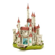 Enter the gateway to pure enchantment with this delicate, highly detailed miniature reproduction of the wicked Queen's castle as depicted in Walt Disney's Snow White and the Seven Dwarfs. Dramatic lighting and window vignettes highlight this limited release sculpt to create a collector's dream come true.