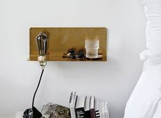 How do you make your home look a little more edgy? Adding a few metal pieces will do the trick, and this 90 Degree Wall Shelf provides an unadorned light bulb as well as a small ledge for your curr… Shelf Lamp, Wall Shelves, 90 Degrees, Home Look, Floating Nightstand, Diy Furniture, Luxury Homes, Everything, Home Accessories