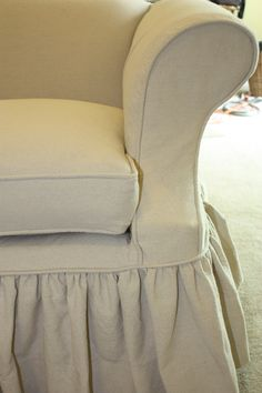 Detail of drop cloth sofa slipcover with full gathered skirt
