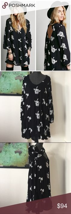 """NWOT Free People Crochet Swing Dress d e s c r i p t i o n  Flowy swing dress from Free People with beautiful floral embroidered design and handy pockets. Elastic band on back and cuffs. Deep """"V"""" in back. Lined. New without tags. NO TRADES.   c o n t e n t  100% rayon   m e a s u r e m e n t s ✂️  size + L 