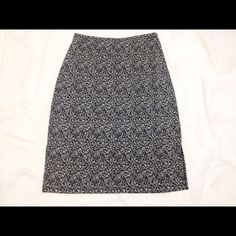 """Fun pencil skirt This is a fun skirt made up of cream, browns, and black. 22"""" in length; 13"""" across the waist and has a 6"""" slit on both sides of skirt (see pic #3).  Have worn less than ten times but has so much life left. Great for work or a night out! Axcess Skirts Pencil"""