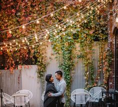 Vancouver engagement session in Gastown on the patio of Tacofino. Romantic engagement portrait under cafe lights