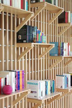 French designer Alexandre Pain created Rossignol, a custom designed wood shelf and railing system that can be used to store books and act as a guard rail for the staircase. Staircase Shelves, Wood Bookshelves, Wood Shelves, Stairs, Office Interior Design, Office Interiors, Interior Decorating, Interior Railings, Interior Walls