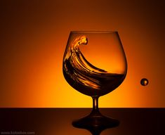 Liquid splash cognac shot splash photography