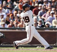 San Francisco Giants' Marco Scutaro hits a sacrifice fly against the Los Angeles Dodgers during the second inning of a baseball game in San Francisco, Saturday, July 6, 2013. (AP Photo/George Nikitin)
