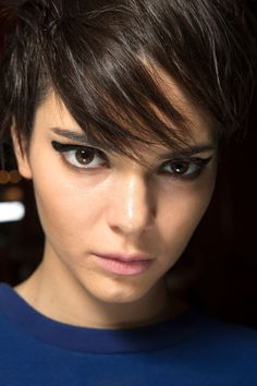 For the hair, Orlando Pita created faux pixie crops with sweeping fringes.