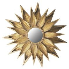 Featuring a floral-inspired silhouette and gold finish, this metal wall mirror brings an eye-catching pop of style to your favorite spaces.