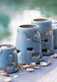 Leads to a magazine Add, unsure of original source - Ceramic lantern & shells