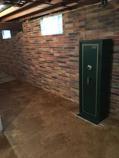 This basement wall is a poured concrete with a brick texture. I decided to paint the walls to look like real bricks, I also stained the concrete floor.