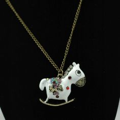 white horse with colourful stones